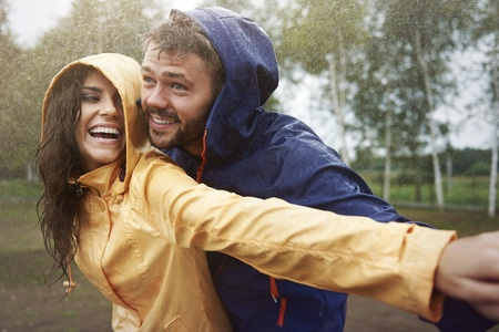 couple in the rain laughing